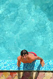 Man in pool. The man in water pool Royalty Free Stock Photos