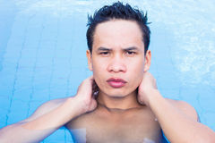 Man in The Pool. Portrait Of Asian Man in The Pool Royalty Free Stock Image