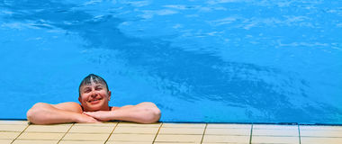 Man at the pool Stock Images