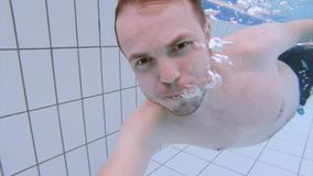 Man in pool at aquapark stock footage