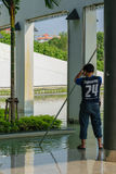 Man pool cleaning Stock Images