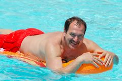 Man on a pool float Stock Photo