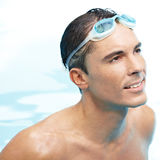 Man in pool with goggles Stock Photography