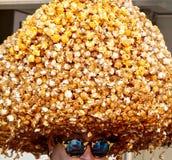 Man wearing a big popcorn hat royalty free stock image