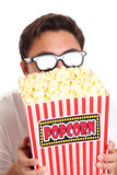 Man with popcorn bucket and 3D glasses Stock Photography
