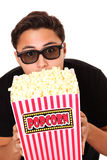 Man with popcorn bucket and 3D glasses Stock Image