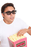 Man with popcorn bucket and 3D glasses Stock Photo
