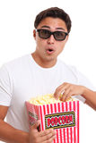 Man with popcorn bucket and 3D glasses Royalty Free Stock Photo