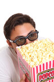 Man with popcorn bucket and 3D glasses Royalty Free Stock Photography