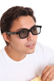 Man with popcorn bucket and 3D glasses Royalty Free Stock Images