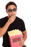 Man with popcorn bucket and 3D glasses Stock Photos