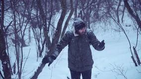 Man with portable radio ser searching signal. Cold man holding portable radio set and trying to catch a signal in blizzard stock video footage