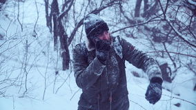 Man with portable radio talking. Cold man holding portable radio set and trying to explain the way for expedition stock footage