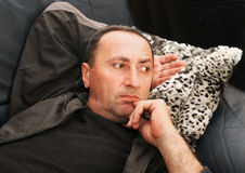 Man portrait. Man relaxing on the sofa Royalty Free Stock Image