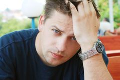 Man portrait. Portrait of a man sitting in the cafe and lean on his hand Stock Images