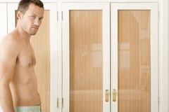 Man portrait in bedroom. Stock Photos
