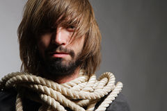 Man portrait with a countage. The man with a rope on a neck Stock Photography