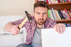 Man portrait and do it yourself furniture assembly stock photo