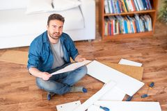 Man portrait and do it yourself furniture assembly royalty free stock images