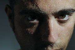 Man portrait with drops. Part of the face of a man steeped Royalty Free Stock Image