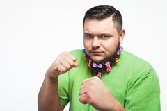Man portrait with hair clips on the beard in boxing pose. Man portrait with hair clips on the beard in boxing stand over white background Royalty Free Stock Photos