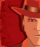 Man portrait in hat on red background Royalty Free Stock Image