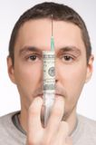 Man portrait holding with money syringe closeup Royalty Free Stock Image