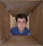 Man portrait inside carton box Royalty Free Stock Photos