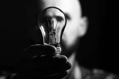 Man portrait with light bulb Royalty Free Stock Photos