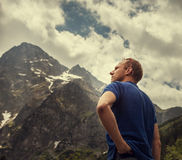 Man portrait on the mountain peaks view Stock Images