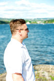 Man portrait with sea on background Royalty Free Stock Photography