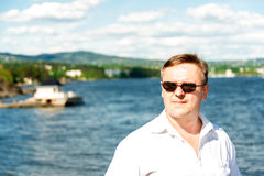 Man portrait with sea on background Royalty Free Stock Image