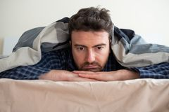Man portrait suffering insomnia trying to sleep royalty free stock photos