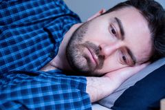 Man portrait suffering insomnia trying to sleep royalty free stock images