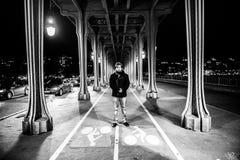 Man portrait under bridge in Paris Royalty Free Stock Images