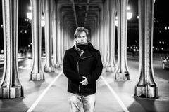 Man portrait under bridge in Paris Stock Photo