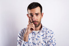 Man portriat over white background, thinking with hand near his Royalty Free Stock Photography