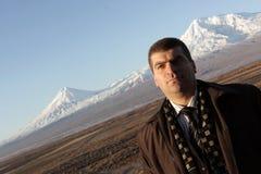 Man poses in Ararat valley. The man poses in Ararat valley, Armenia Royalty Free Stock Photos