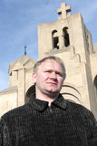 Man Poses On Church Background Royalty Free Stock Image