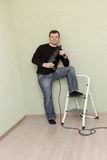 Man poses with perforator Stock Photo