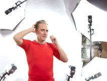 Man poses for the photographer in studio Stock Photos