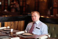 Man poses in restaurant Royalty Free Stock Photography
