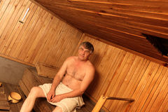 Man poses in sauna Stock Photography