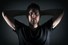 Man posing with angry face and dark background Royalty Free Stock Photos