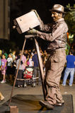 A man posing as a living statue at a festival Royalty Free Stock Photos