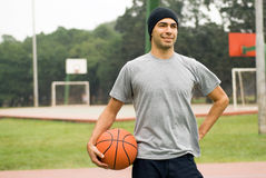 Man Posing With Basketball - horizontal Royalty Free Stock Image