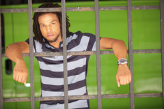 Man posing behind bars Stock Photos
