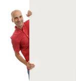 Man posing behind a billboard Stock Photography