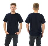 Man posing with blank dark blue shirt. Photo of a man wearing blank dark blue t-shirt, front and back. Ready for your design or artwork stock photo