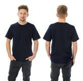 Man posing with blank dark blue shirt Stock Photo